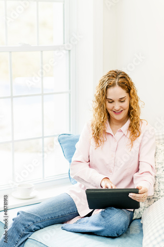 Woman with tablet computer at home