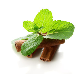 Mint with cinnamon isolated on white