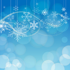 abstract snowflakes on blue bokeh background