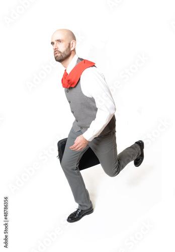 Gestresster Geschäftsmann läuft