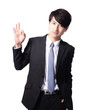 smiling young business man with okay gesture