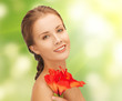 lovely woman with red lily flower