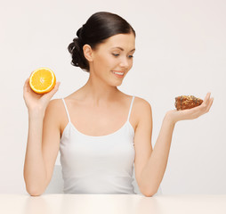 woman with cake and orange