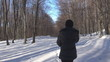 Young woman walking in forest, winter time