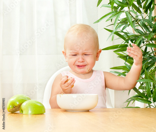child at the table does not want to eat