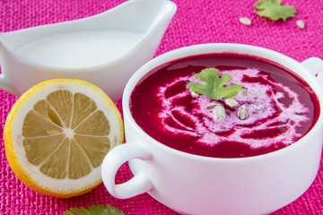 Beetroot cream soup with sunflower seeds and lemon