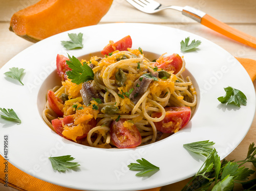 spaghetti with pumpkin anchovy caper and fresh tomatoes