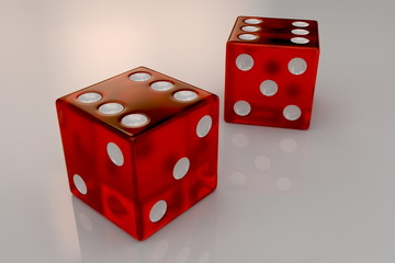 Two glossy red plastic bouncing dices