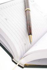 codzienny notes z długopisem