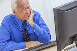 Senior Man Having Trouble Using Computer