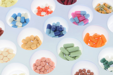 Assortment of pills and capsules of colours. Medication varied s