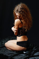 beautiful young woman in black lingerie