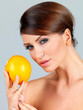Sensual woman with an orange