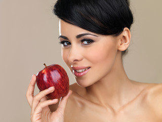 Beautiful brunette with a red apple