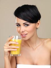 Woman enjoying a glass of orange juice