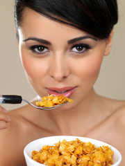 Beautiful woman eating cereal