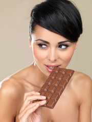 Beautiful woman with a bar of chocolate