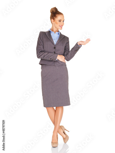 Stylish businesswoman holding out her palm