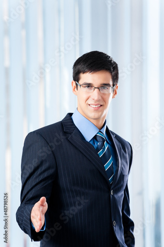 Young businessman giving hand for handshake