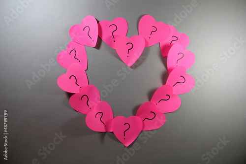 Adhesive love notes on the gray background