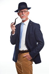 Well dressed senior man with glasses smoking pipe. Isolated.