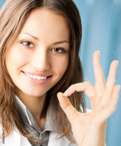 Smiling doctor with okay gesture