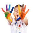 Little boy with hands painted in colorful paints ready for hand