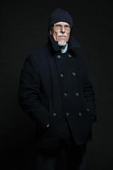 Good looking senior man winter fashion. Studio shot.