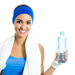Woman in fitness wear with water, over white