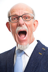 Angry well dressed senior man with glasses. Isolated.