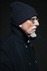 Good looking senior man winter fashion. Studio shot.