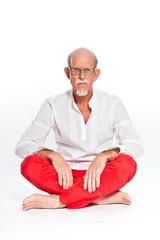 Spiritual senior man with glasses. Isolated on white.