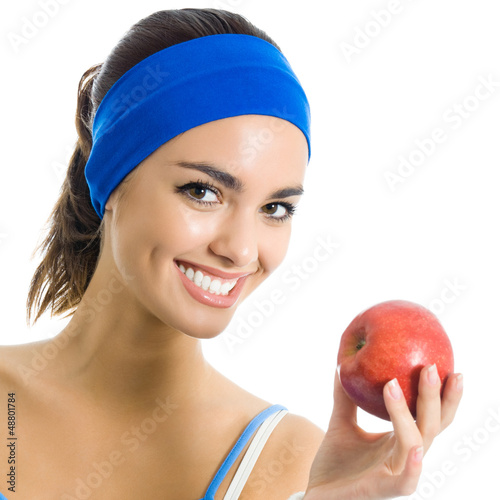 Young woman with apple, over white