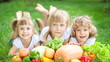 Group of happy children having picnic outdoors