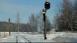 Railroad worker  with cell phone on signal beacons pole