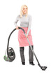 Full length portrait of a woman cleaning with hover