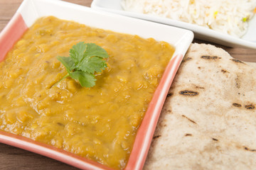 Tarka Dal - Indian yellow lentil curry with rice and chapatis