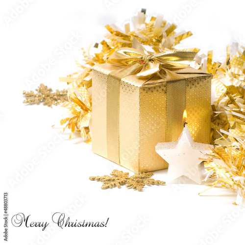 Gold christmas gift with candle