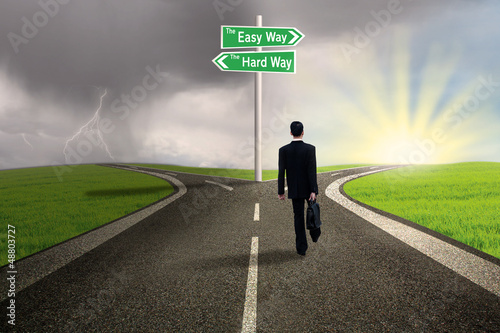 Businessman choosing easy way road