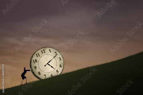 Businesswoman pushing time outdoor