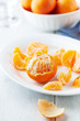 Peeled mandarin oranges on a plate