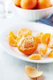 Peeled mandarin oranges on a plate