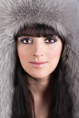 Portrait of young beautiful woman in winter furry hat