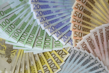 The back of euro notes form a pinwheel