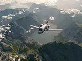 aircraft flies over a mountain range