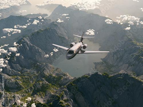 aircraft flies over a mountain range