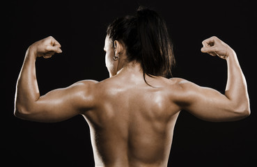 Back muscles of naked fitness woman.