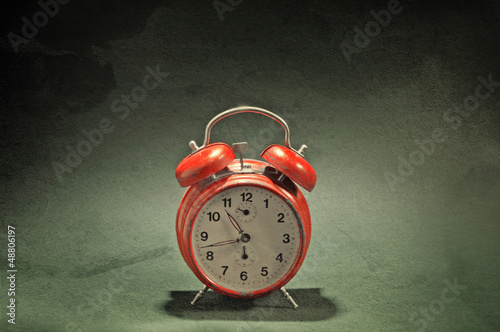 Red old style alarm clock