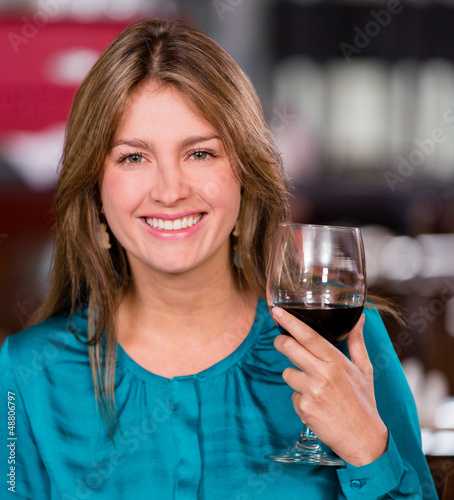 Woman having a glass of wine