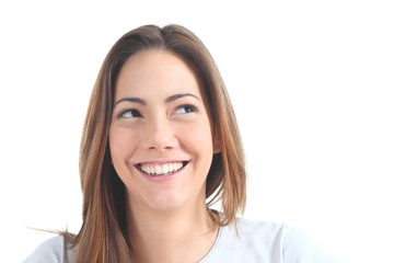Woman smiling with her eyes looking at side